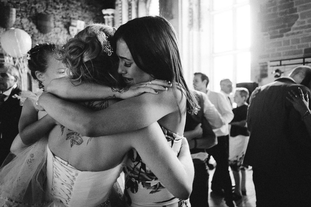 Emotional moment between bride and bridesmaid at Caerphilly Castle wedding photography