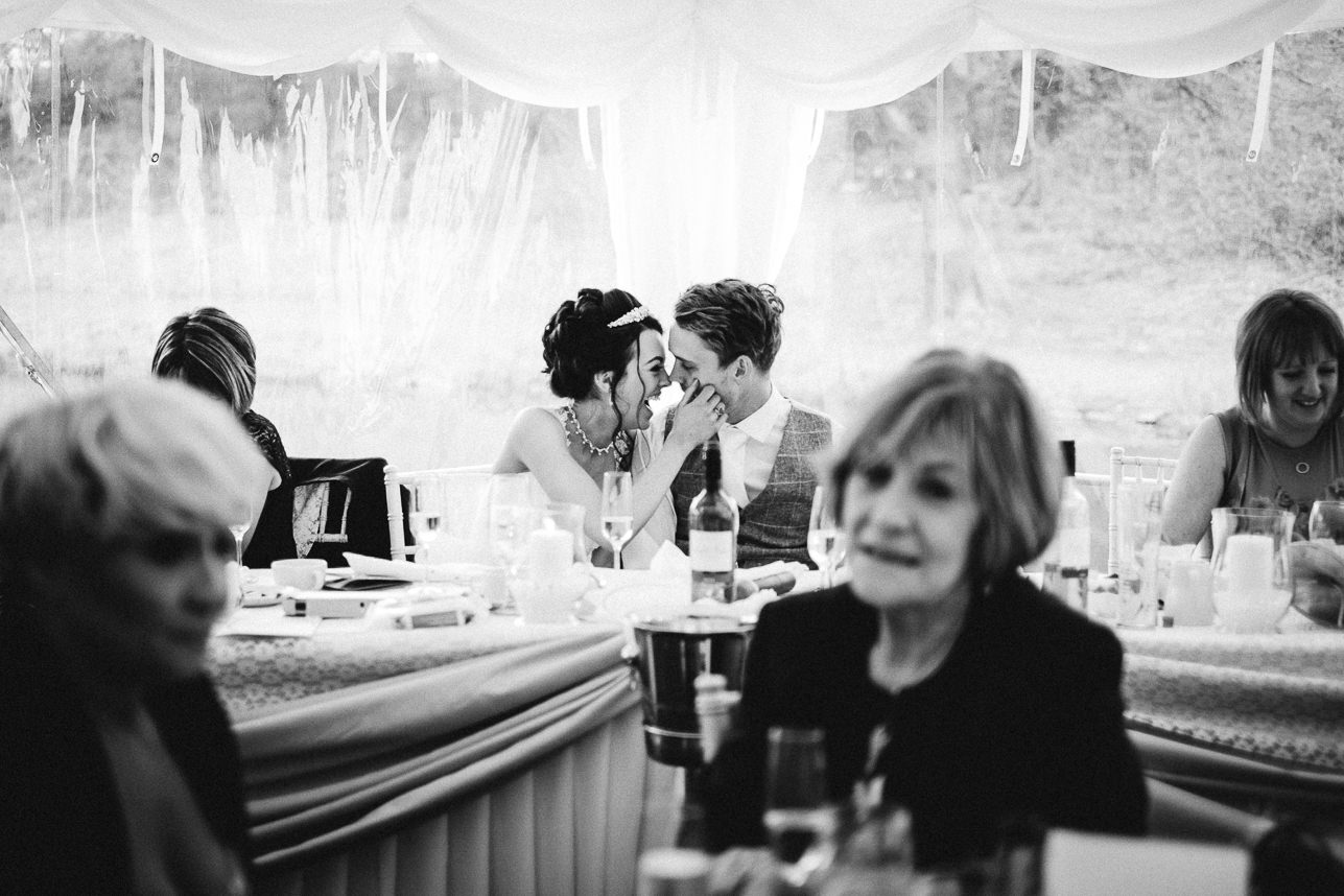 Black and white shot bride and groom kiss Lakeside Venue Bridgend wedding photographer