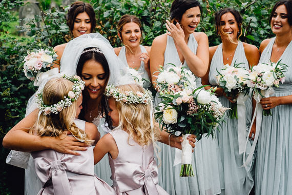 documentary wedding photography candid moment between bride flowergirls bridesmaids