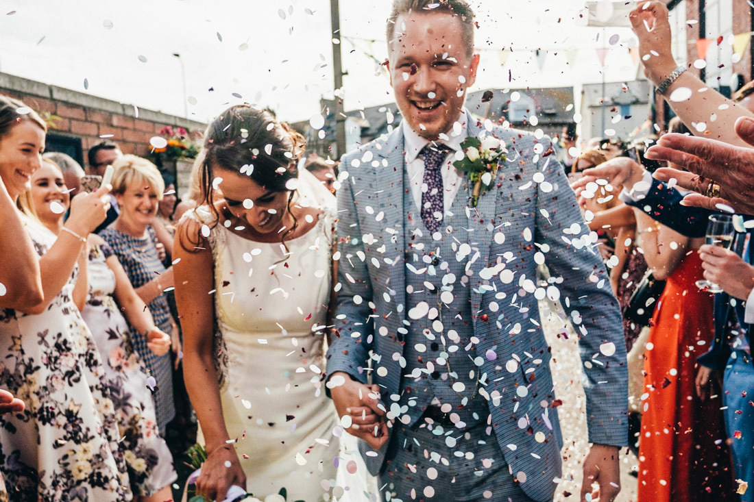 002 COLOURFUL CONFETTI SHOT BRIDE AND GROOM WEDDING RECEPTION TRAMSHED CARDIFF WEDDING PHOTOGRAPHY