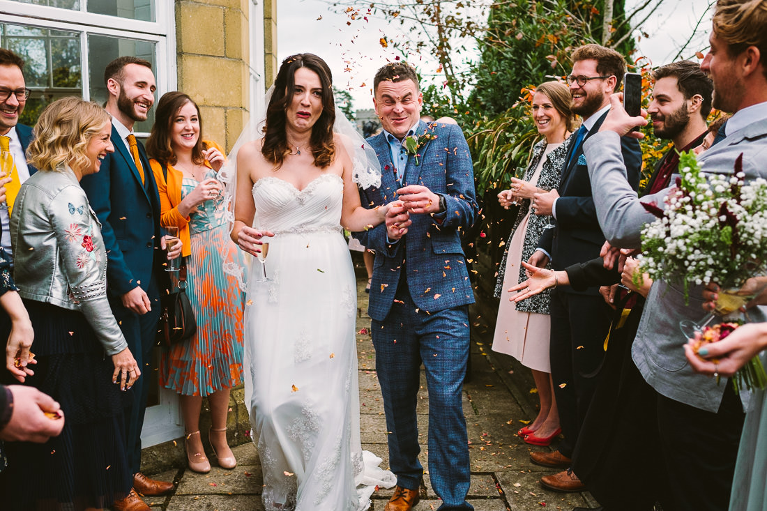 002 FUNNY CONFETTI SHOT AT PETERSTONE COURT WEDDING PHOTOGRAPHY BRECON BEACONS