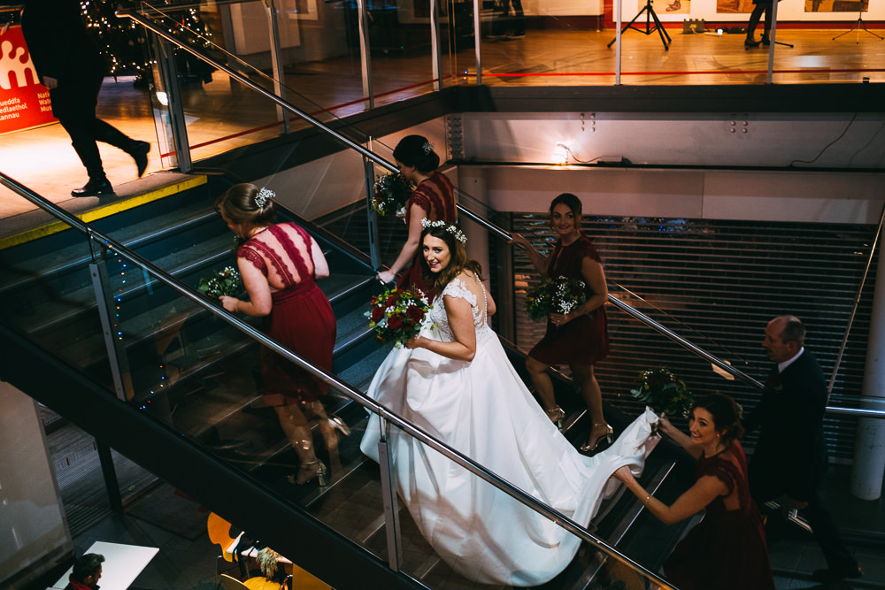 001 BRIDE BRIDESMAIDS MAKING BRIDAL ENTRANCE NATIONAL WATERFRONT MUSEUM WEDDING PHOTOGRAPHY SWANSEA