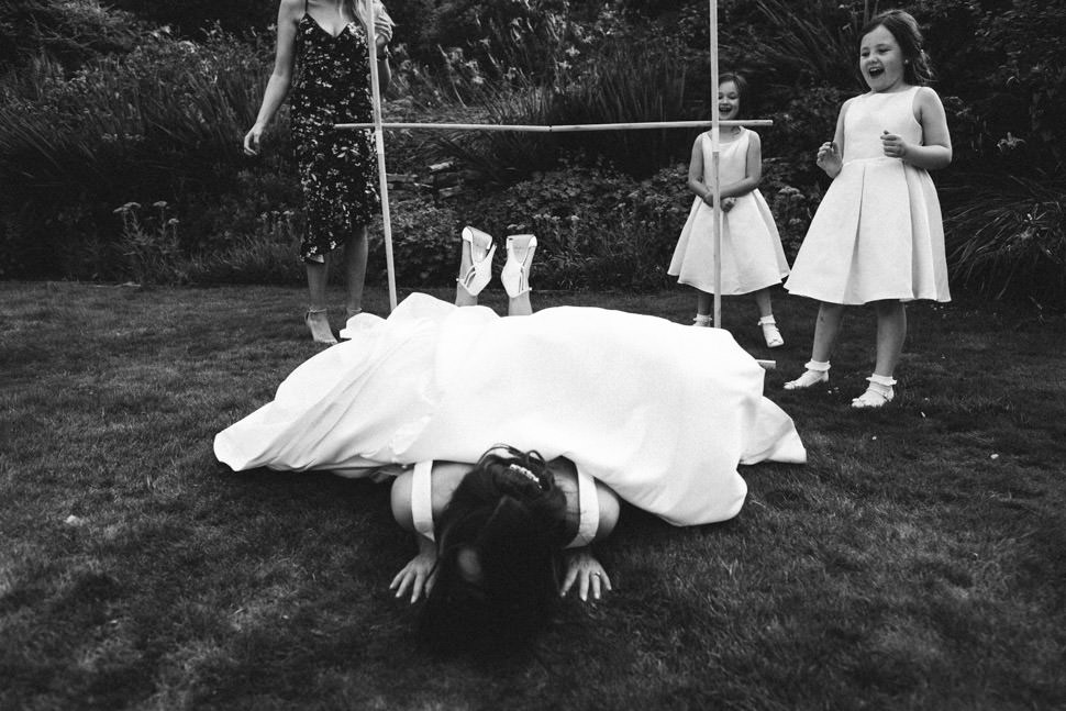 Fun bride falling doing limbo at wedding at The Falcondale Lampeter West Wales wedding photographer